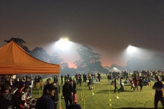 Surreal backdrop as the bush burnoff smog rolls over, adding to the atmosphere.